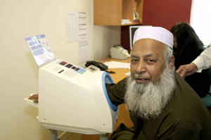 Imam (Muslim Priest) of Hyde mosque learning how to check his own blood pressure at a Self Care meeting held for patients of the practice earlier