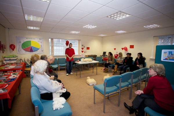 Patients, college students and Haughton Thornley Patient Participation Group learning Basic Life Support together with Geoff Pogson