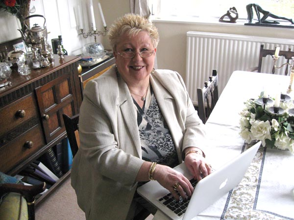 Jane Webster in front of her computer at home