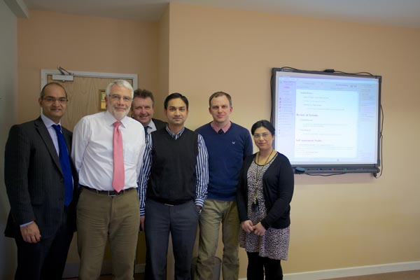 Dr Hannan, Dr Richard Sills. Glen Griffiths, Dr Dr Ramaswamy, John Witte and Dr Ullah seeing Instant Medical History
